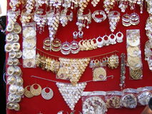 Traditional Oriental Arabic jewelry on display for sale in souk market Royalty Free Stock Photography