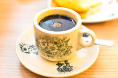 Traditional oriental Chinese black coffee in vintage cup. Traditional oriental Chinese black coffee or kopitiam in vintage mug, fractal on the cup is generic Royalty Free Stock Images