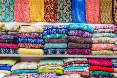 Traditional oriental cloth sold in a store in old town Dubai. United Arab Emirates stock photography