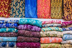Traditional oriental cloth sold in a store in old town Dubai. United Arab Emirates royalty free stock photo