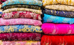 Traditional oriental cloth sold in a store in old town Dubai. United Arab Emirates stock photo