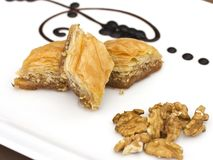 Traditional oriental dessert - baklava with pistachios and walnuts. Isolated. Traditional oriental dessert - baklava with the pistachios and walnuts. Isolated stock photography