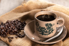 Traditional oriental Hainan coffee in vintage mug Royalty Free Stock Images