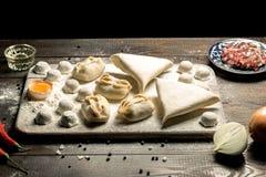 Traditional oriental, Uzbek cuisine, chuchvara, manti and samsa, a set of dishes made in one set stock photo