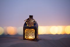 Traditional ornamental arabic candle in desert.