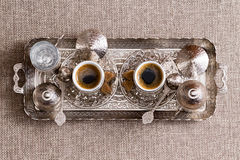 Traditional ornate metal tray with Turkish coffee Stock Photo