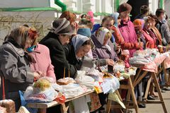 Traditional orthodox paschal ritual - people put easter eggs and Stock Photos