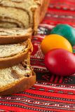 Traditional orthodox sponge cake and colored easter eggs. Orthodox easter tradition Stock Photography