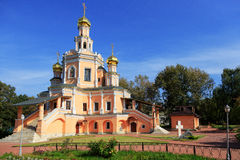 Traditional orthodox temple with gold domes against the blue sky. Stock Photos