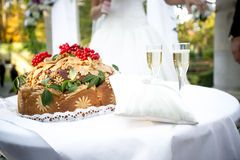 Traditional orthodox wedding bread lying on ceremonial table Royalty Free Stock Image