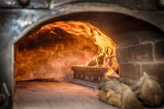 A traditional oven for baking pizza Stock Images