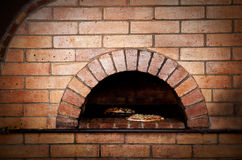 Traditional oven for cooking and baking pizza. Royalty Free Stock Photo