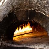 A traditional oven for cooking and baking pizza. Stock Photos