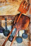 Traditional oven and cooking utensils. Picture of traditional oven and cooking utensils arranged against a stone wall Stock Photos