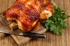 Traditional Oven Roasted Chicken on Wooden Serving Board Royalty Free Stock Photos