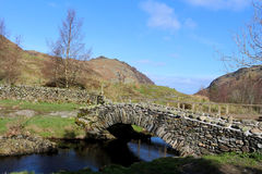 Traditional packhorse bridge, Watendlath, Cumbria. View of the traditional packhorse bridge at Watendlath in the English lake District, Cumbria, England on a Royalty Free Stock Images
