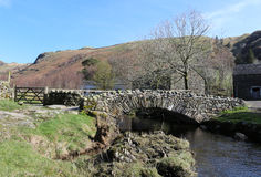 Traditional packhorse bridge, Watendlath, Cumbria. View of the traditional packhorse bridge at Watendlath in the English lake District, Cumbria, England on a Royalty Free Stock Photo