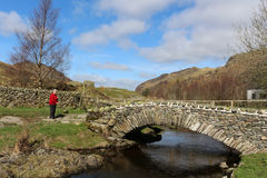 Traditional packhorse bridge, Watendlath, Cumbria. View of the traditional packhorse bridge at Watendlath in the English Lake District, Cumbria, England on a Royalty Free Stock Photography
