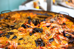 Traditional paella with seafood in a market Royalty Free Stock Photo