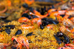 Traditional paella with seafood in a market Stock Image