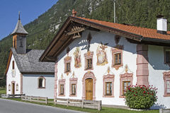 Traditional painted buildings in Tirol Stock Image