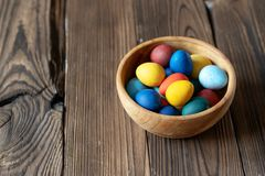Traditional painted eggs for easter in a wooden bowl stock photos