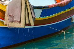 Traditional painted fisherman boat in Marsaxlokk village,Malta.  Royalty Free Stock Photography
