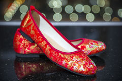 A traditional pair of red wedding shoes. Stock Photo