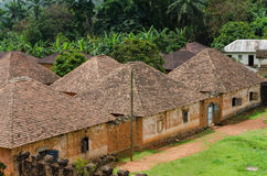 Traditional palace of the Fon of Bafut with brick and tile buildings and jungle environment, Cameroon, Africa. Traditional and historical palace of the Fon of royalty free stock photo