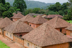 Traditional palace of the Fon of Bafut with brick and tile buildings and jungle environment, Cameroon, Africa Royalty Free Stock Photos