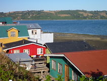 Traditional palafitos houses on woodem columns in chiloe Royalty Free Stock Image