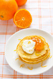 Traditional pancakes. With whipped cream, orange jam and zest Royalty Free Stock Photo