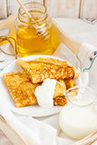 Traditional pancakes. With organic honey and fresh cream Royalty Free Stock Photos
