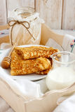 Traditional pancakes. With organic honey and fresh cream Stock Images