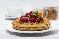 Traditional pancakes with fresh raspberries for breakfast. On wooden table, horizontal Royalty Free Stock Images