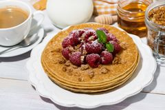 Traditional pancakes with fresh raspberries for breakfast. On wooden table, top view closeup Royalty Free Stock Photography