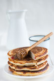 Traditional pancakes with honey Stock Photos