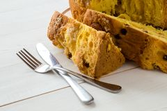 Traditional panettone with dried fruits and orange zest, piece of cake, close up stock photos