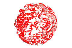 The traditional paper-cut. The Chinese phoenix and dragon on the white royalty free stock images