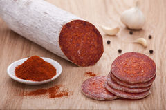 Traditional paprika salami on board with garlic Royalty Free Stock Image