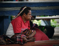 Traditional papua woman on the market in Wamena at Royalty Free Stock Images