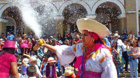 Traditional parade during Carnival. Woman dancer is spraying foam on everyone. royalty free stock images