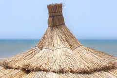Traditional parasol at the beach in Essaouira. Royalty Free Stock Photos