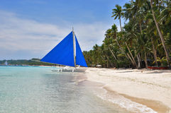 Traditional paraw sailing boat on white beach. On boracay island. philippines Royalty Free Stock Photo