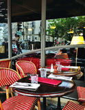 Traditional Parisian coffee. Street view of a coffee terrace with tables and chairs,paris France Stock Images