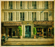 Traditional Parisian house with cafe. Old photo Royalty Free Stock Photo