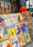 Traditional Parisian Posters in Montmartre. PARIS, FRANCE - JUNE 6, 2012: Traditional Parisian posters on display at a pavement stall in Montmartre in Paris Stock Image