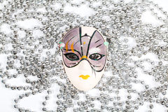 Traditional party mask among silver beads Stock Photography