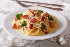 Traditional pasta carbonara with bacon and parmesan close-up Stock Image