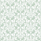 Traditional pattern. Light green abstract scroll shape like butterfly on white background Stock Photography